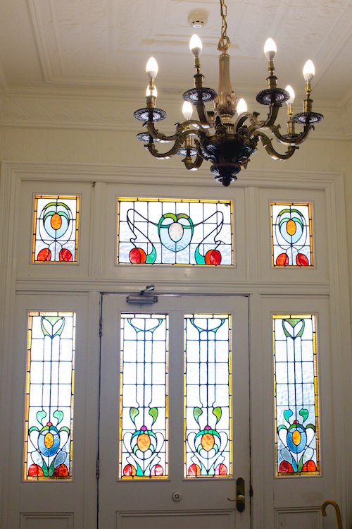 Stained glass and vintage chandelier Peppers Convent.