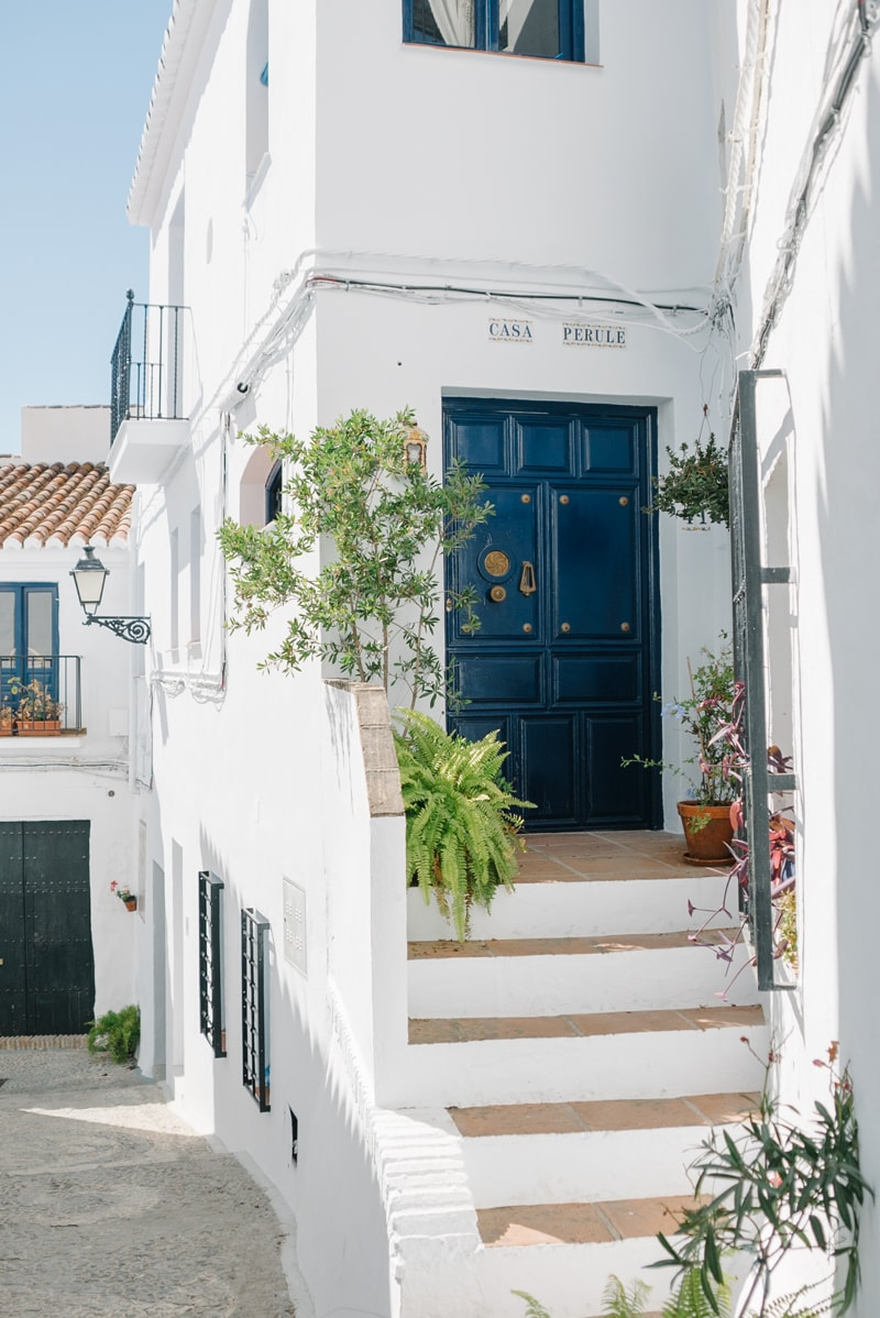 Traditional house with blue door in Frigiliana.