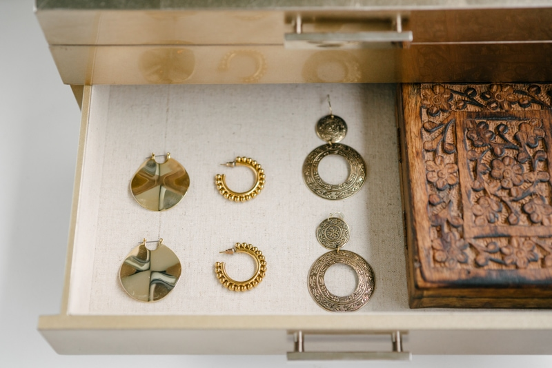 gold hoops earrings in a jewellery box